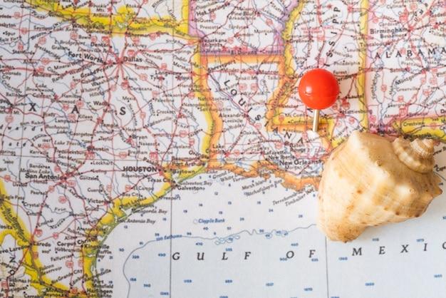 Kaart van de verenigde staten van amerika en zeeschelp Gratis Foto
