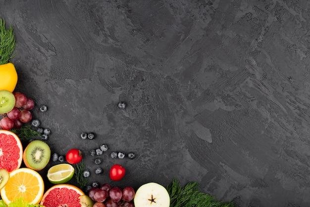 Kader grunge achtergrond met fruit Gratis Foto