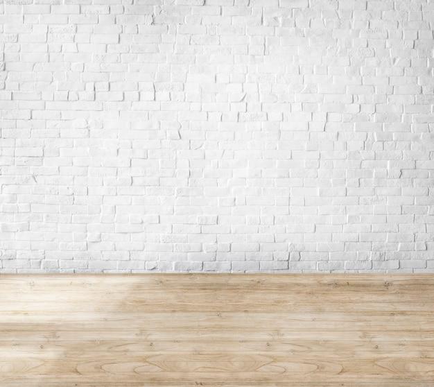 Kamer gemaakt van bakstenen muur en houten vloer Gratis Foto