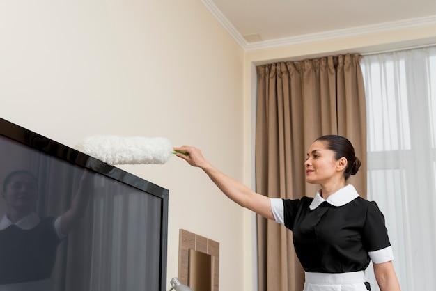 Kamermeisje schoonmaak hotelkamer Gratis Foto