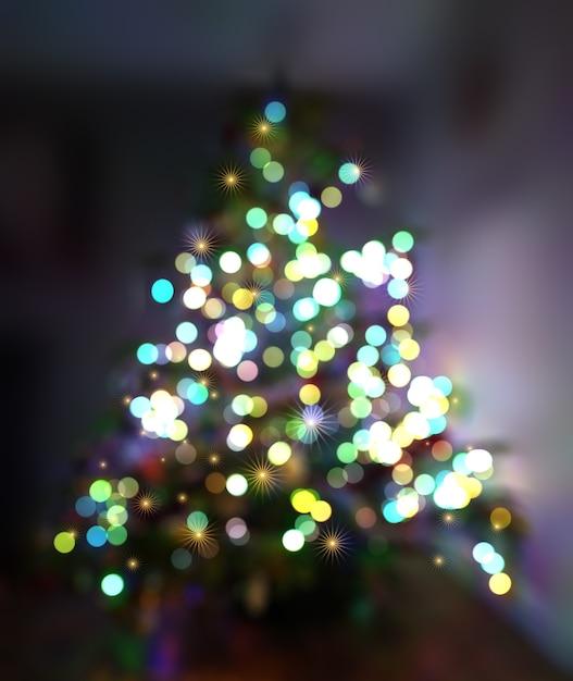 Kerst achtergrond met defocussed boom en verlichting Gratis Foto