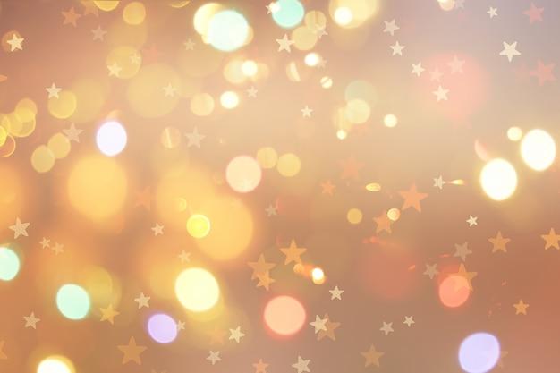 Kerst achtergrond met sterren en bokeh lichten Gratis Foto