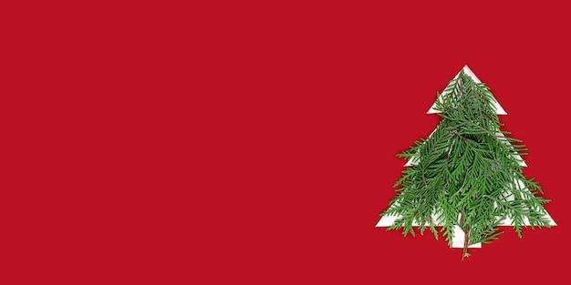 Kerstboom uit papier gesneden op een rode muur. silhouet van een kerstboom met groene fir takken. kerstboom papier snijden ontwerp kaart. papierkunst met kopie ruimte. Premium Foto