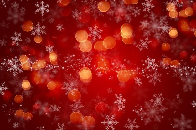 Kerstmisachtergrond met een sneeuwvlokontwerp en bokehlichten Gratis Foto