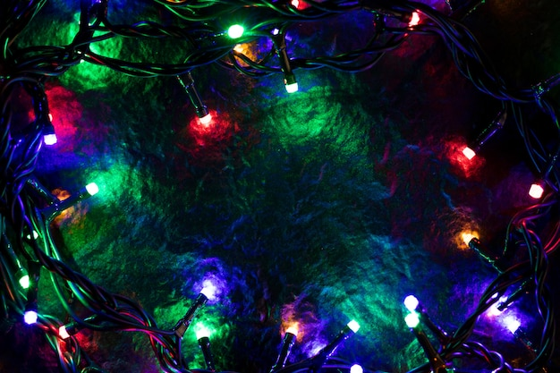 Kerstmisachtergrond met lichten en vrije tekstruimte. Premium Foto