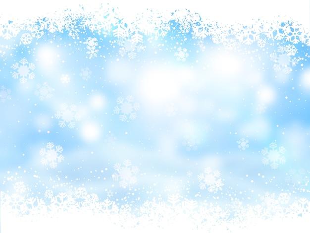 Kerstmisachtergrond met sneeuwvlokkenontwerp Gratis Foto