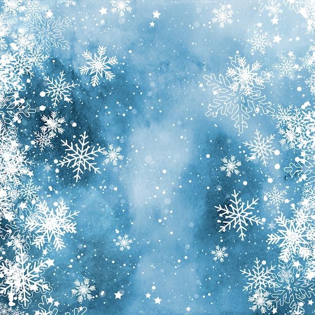 Kerstmissneeuwvlokken op een waterverftextuur Gratis Foto