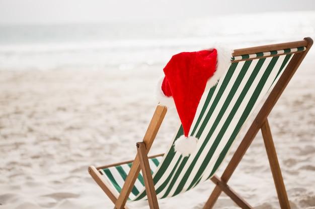 Kerstmuts bleef leeg strand stoel Gratis Foto