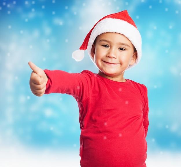 Kid met duim omhoog Gratis Foto
