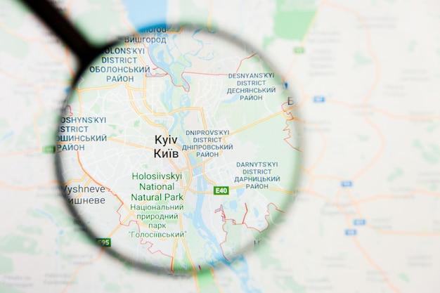 Kiev, oekraïne stad visualisatie illustratief concept op het beeldscherm door vergrootglas Premium Foto