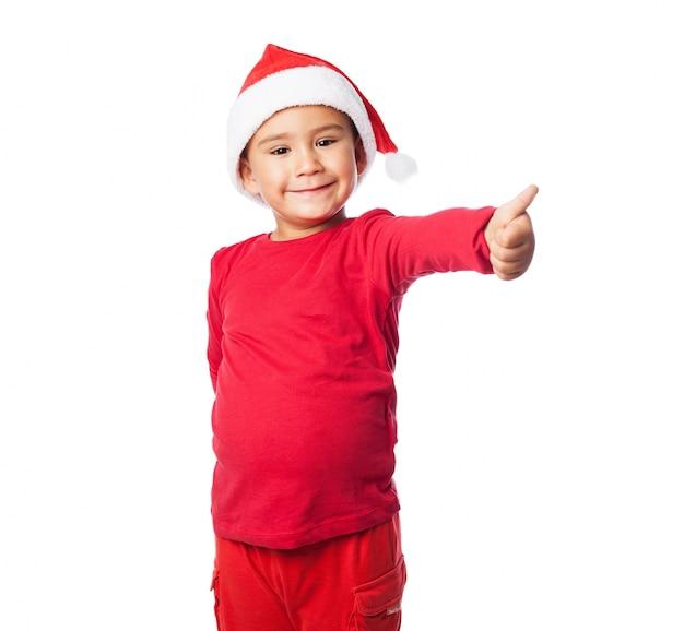 Kind met duim omhoog en rode jurk Gratis Foto