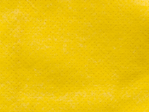 Kleine gestippelde gele stoffen textiel textuur Gratis Foto