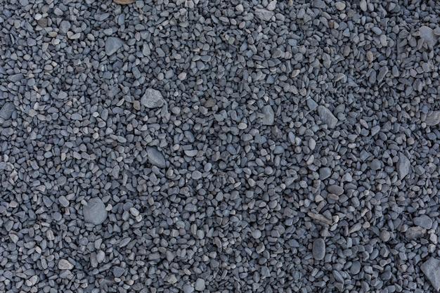 Kleine grijze stenen voor constructie op de grond Gratis Foto