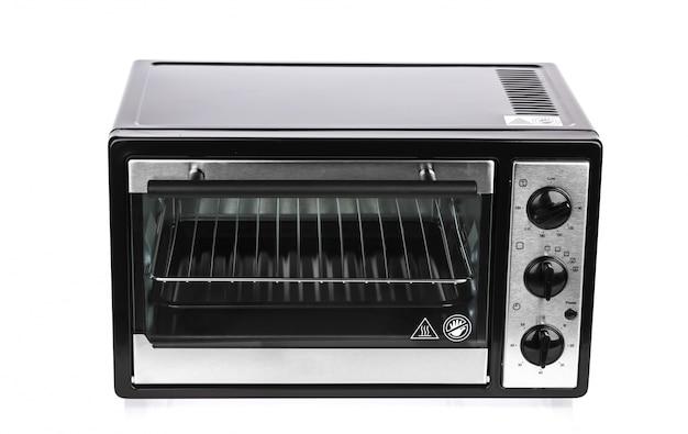 Kleine oven op een witte achtergrond Gratis Foto