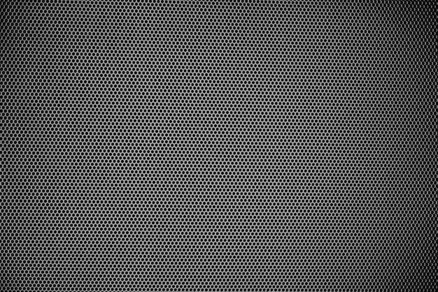 Kleine zwarte stippen die naar kijken worden verblind door vele zwarte stippen van metalen plaatjes achtergrond Premium Foto