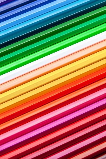 Kleur potloden achtergrond Premium Foto