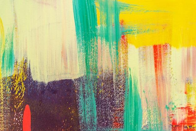 Kleurrijk geschilderd op concrete muur abstracte achtergrond. retro en vintage achtergrond. Premium Foto