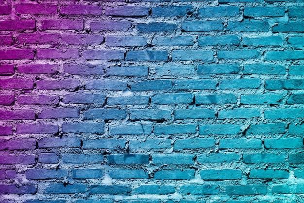 Kleurrijke geschilderde bakstenen muur textuur achtergrond. graffitibakstenen muur, kleurrijke achtergrond. Premium Foto