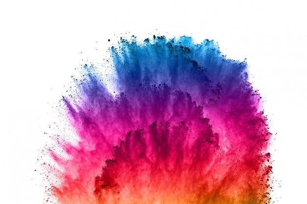 Kleurrijke poederexplosie op wit. Premium Foto