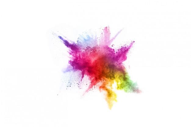 Kleurrijke poederexplosie op witte achtergrond. Premium Foto