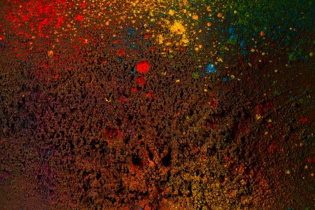 Kleurrijke poederkleuren op zwarte achtergrond Gratis Foto