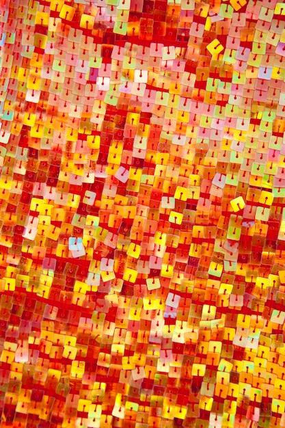 Kleurrijke rode gele lovertjes met vierkante vorm Premium Foto