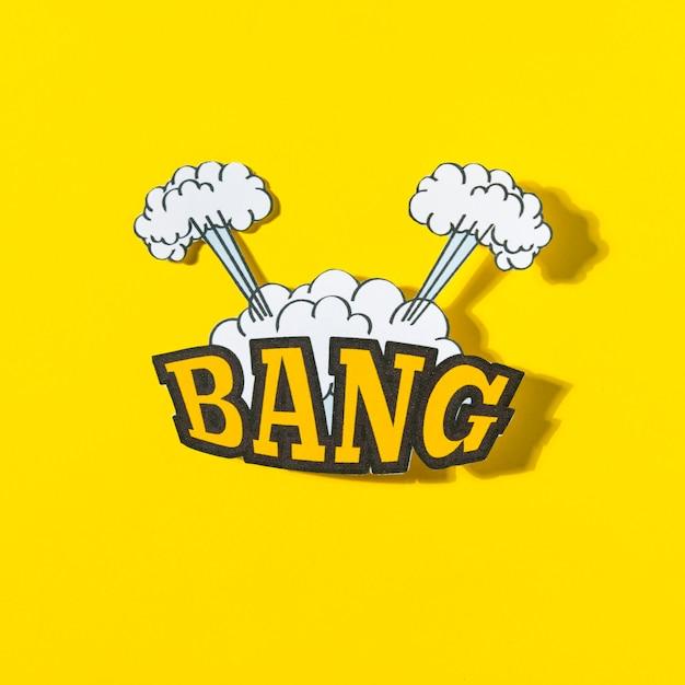 Knal tekst met explosiewolk in grappige stijl tegen gele achtergrond Gratis Foto