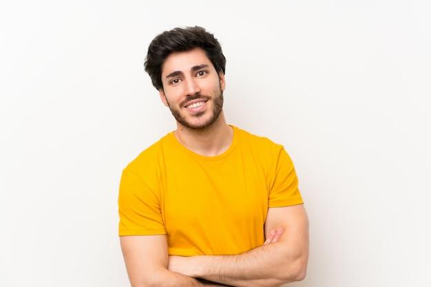 Knap over het geïsoleerde witte muur lachen Premium Foto