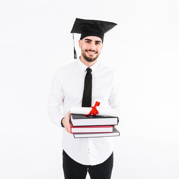 Knappe man met boeken en diploma Gratis Foto