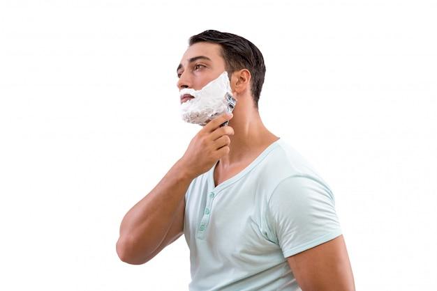 Knappe man scheren geïsoleerd op wit Premium Foto