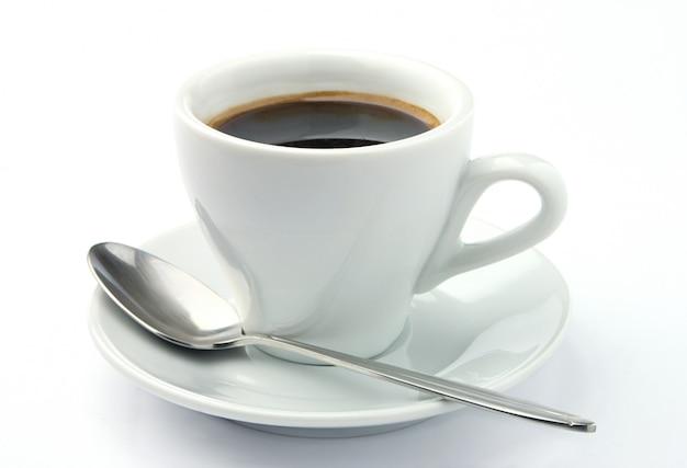 Koffiekopje en lepel Premium Foto