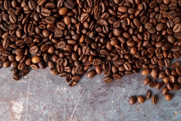 Kopieer de ruimte koffiebonen plat lag Gratis Foto