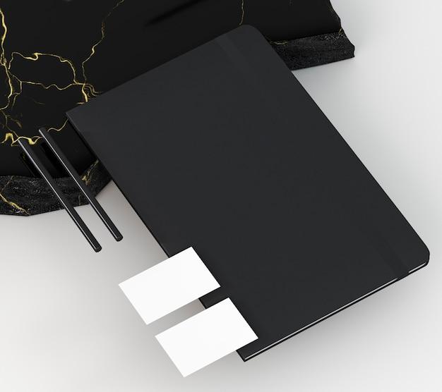 Kopieer ruimte visitekaartje en zwarte notebook Gratis Foto