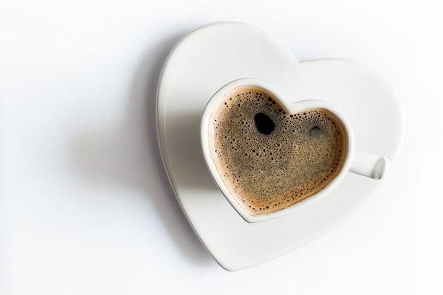 Kopje koffie in de vorm van hart Gratis Foto