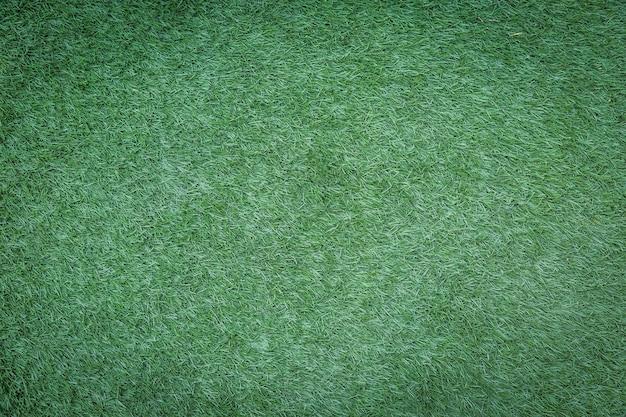 Kunstmatig groen grasgebruik voor achtergrond Premium Foto