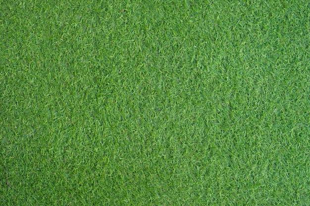 Kunstmatige groene grastekst en achtergrond Premium Foto