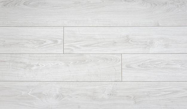 Laminaat achtergrond. houten laminaat- en parketplanken voor de vloer in het interieur. textuur en patroon van natuurlijk hout Premium Foto