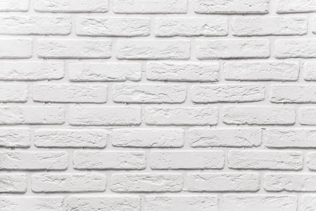 Lange witte bakstenen muurachtergrond. de textuur van de oude baksteen beschilderd met witte verf Premium Foto
