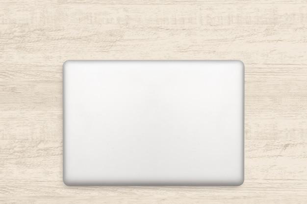 Laptopcomputer op witte houten achtergrond. Premium Foto