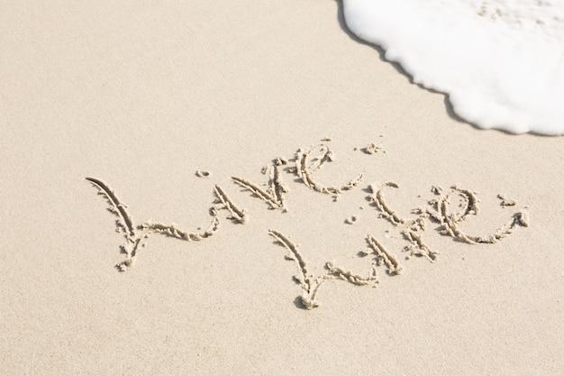 Leef het leven op zand wordt geschreven Gratis Foto