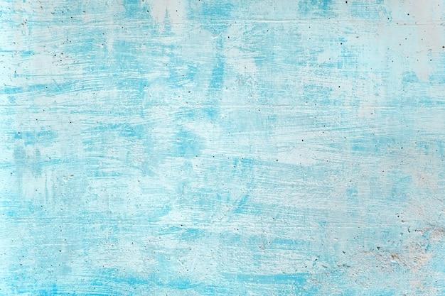 Lege blauwe de zeekleurenverf van de grunge concrete muur voor textuur. vintage achtergrond Premium Foto