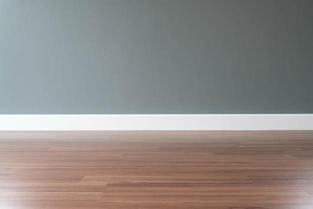 Lege muur met een houten vloer hieronder foto gratis download