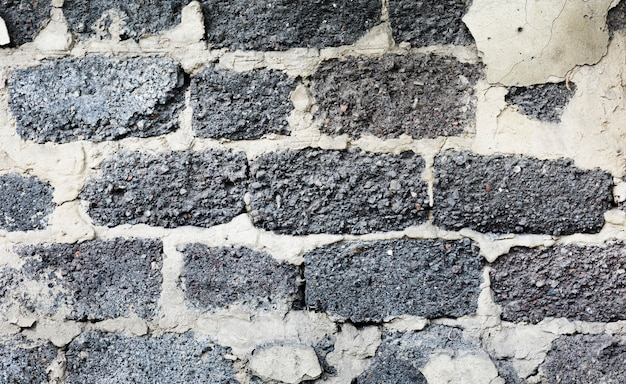 Lege oude grijze bakstenen muurtextuur Gratis Foto