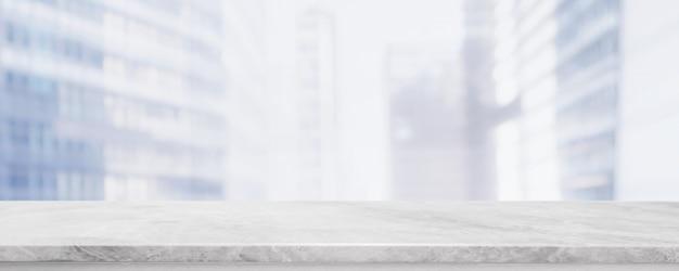 Lege witte marmeren stenen tafelblad en vervagen glazen venster muur gebouw Premium Foto