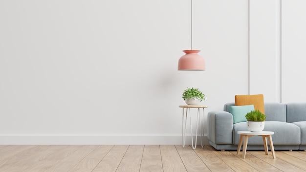 Lege woonkamer met blauwe bank, planten en tafel op lege witte muur achtergrond. 3d-weergave Gratis Foto