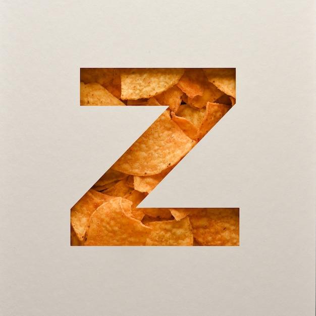 Lettertypeontwerp, abstract alfabet lettertype met driehoekige maïs chips, realistische bladeren typografie - z Premium Foto
