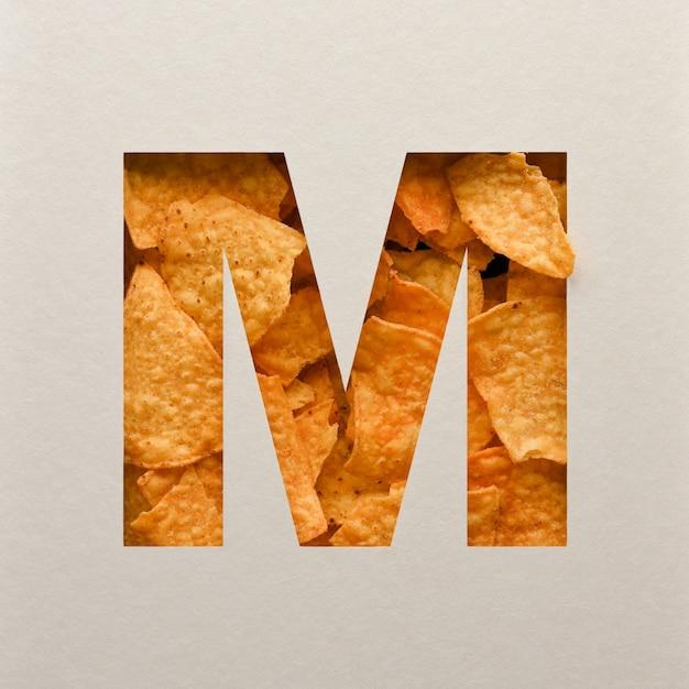 Lettertypeontwerp, abstract alfabet lettertype met driehoekige maïsspaanders, realistische blaadentypografie - m. Premium Foto