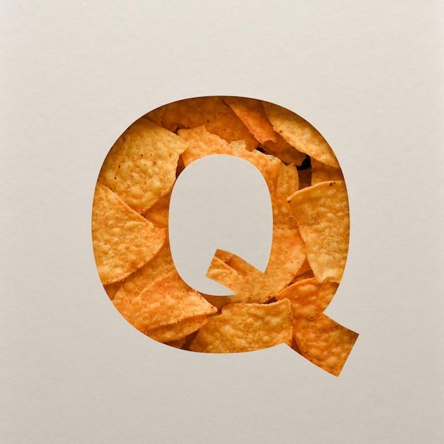 Lettertypeontwerp, abstract alfabet lettertype met driehoekige maïsspaanders, realistische blaadentypografie - q Premium Foto