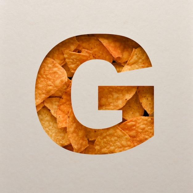 Lettertypeontwerp, abstract alfabet lettertype met driehoekige maïsspaanders, realistische bladeren typografie - g. Premium Foto