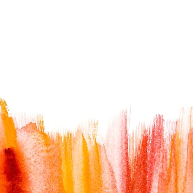 Levendige aquarel penseelstreek op witte achtergrond Gratis Foto